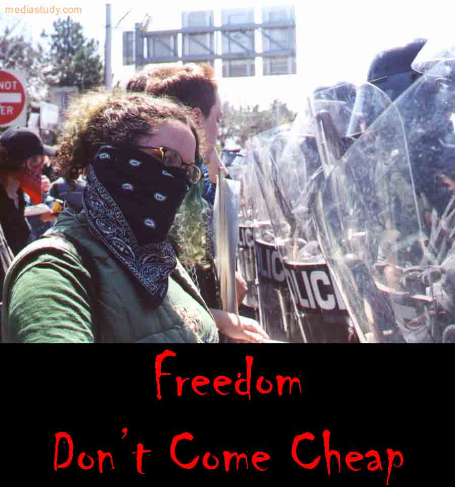 "Photo Citizen vs. Riot Police with Caption: ""Freedom Don't Come Cheap"""